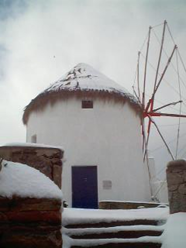MYKONOS WINDMILLS WITH SNOW AT WINTER